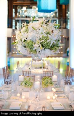 A glowing tablescape in white #weddings #centerpieces #blisschicago