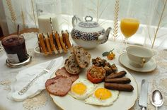 Irish breakfast:  vary from county to county, you'll generally find the following on your plate: sausages, bacon, fried eggs, black pudding, and white pudding. Sometimes it is accompanied by a slide of Irish soda bread.