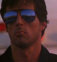 Stallone is cool as Cobra, Barney Ross, John Rambo, Rocky Balboa, etc. Stallone Cobra, Stallone Rocky, Pulp Fiction, Silvestre Stallone, John Rambo, Ray Bans, Cult, Rocky Balboa, Actrices Hollywood