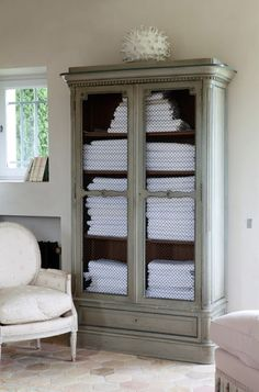 cabinet use an armoire in the bathroom for linens, chicken wire so it breathes, great idea