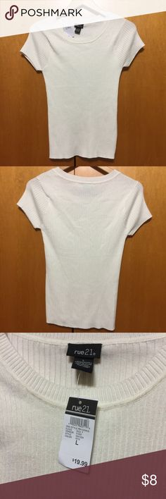 Ivory Fitted Ribbed Top Cute cream or ivory color. New with tags. Ribbed Knit material. Round neck. Fitted and really Stretchy. No flaws. Tops