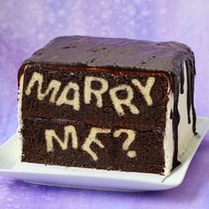 """Bake up a proposal! Stuff a personalized message, like the question, """"Marry Me?"""", inside a cake."""