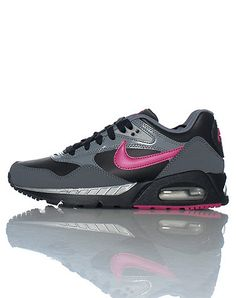 NIKE Women's low top sneaker Lace up closure Padded tongue with NIKE logo Contrasting NIKE swoosh on side of shoe Cushioned sole for ultimate comfort
