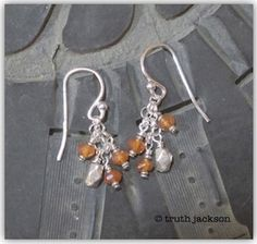 Faceted carnelian rondelles, Hilltribe silver & sterling silver earwires. $24