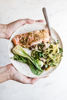 If you haven't ever used a parchment pouch to cook your entire dinner now is the time. This easy dinner is loaded with flavor and takes less than 30 minutes start to finish! #salmon #dinner #family #health #wholefood