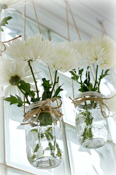Mason jar window treatment idea using mason jars as vases and jute string.