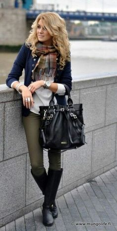 Dark skinnies with boots, white t, and a navy military jacket. Easy fall look.