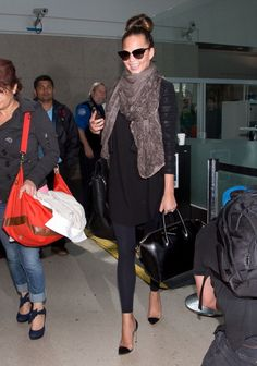 Chrissy Teigen kept it casual and chic at LAX airport punched up by a Givenchy bag and Gianvito Rossi perspex pumps.