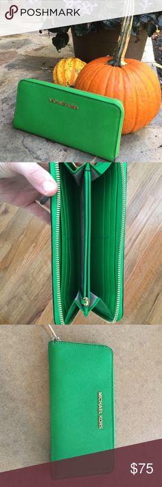 Michael Kors green zip up wallet Authentic beautiful emerald green zip up Michael Kors wallet. Michael Kors Bags Wallets