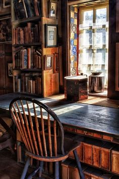 What a gorgeous room! Old books, rustic desk and this lovely chair by the window. I'd love to write my patterns in a room like this!