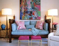 Wonderful blue sofa with Manuel Canovas fabric on the pillows. Hot pink stools and a large abstract art add lots of interest to this Joe Nye room