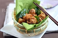 Salt and Pepper Chicken (盐酥鸡): five-spice powder marinated fried chicken served with fried basil leaves.