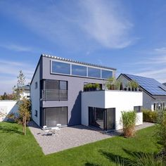 Modernes Pultdach-Haus mit Büroanbau von Kitzlinger | Haus & Bau | zuhause3.de