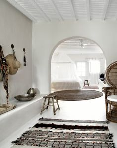 white room and peacock chair