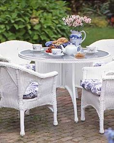 Classic White Wicker Patio Set with Blue and White Floral Cushions