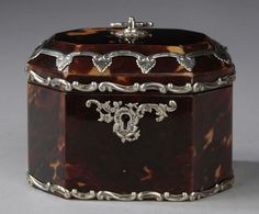 A small octagonal tortoiseshell and silver tea caddy by Martin Hall & Co, Shrewsbury, Sheffield.