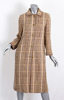 Chanel wool tweed coat, 1970s. Made from herringbone wool tweed plaid, the enchanting—and unusual—pastel peach color will be admired. The impeccable Chanel cut and tailoring make this a timeless classic.