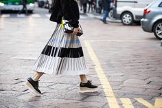 Woman wearing pleated skirt and Stella McCartney wedges before the Philosophy Fall/Winter 2015-2016 fashion show in Milan, Italy
