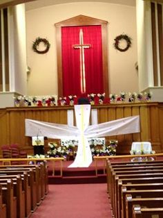 """Easter Sunday Fort Dodge, IA First United Methodist Church, before congregation began arriving.  Glue dots held horizontal fabric on the wood """"wall"""" between narthex and choir loft.  With altar behind the fabric cross, the communion table was added to the right for bread and juice."""