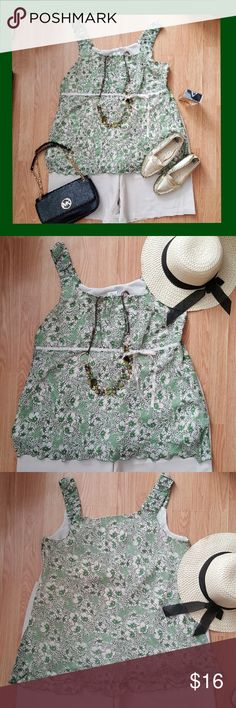 Beautiful sleeveless Blouse/Top 100% Polyester Pretty Green/White Flowered Top. Dress up or casual. Ribbon at waist. Zipper on side. Lightweight with liner. Pretty detailed trim. Pleated top portion. Perfect Summer addition to any wardrobe. Size 18W Tops