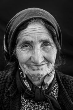"""The Last Tattooed Women of Kobane - Amina Abdel Majid Suleyman, about 70, from Kobane, at Rojava refugee camp in Suruc, Turkey. She is the mother of seven children and cares for two grandchildren whose mother died. """"I was tattooed as a baby, probably when I was about six months old,"""" she says."""