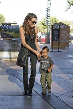 Angelina Jolie - classic Angelina... Black on black on black.. With aviators and boots