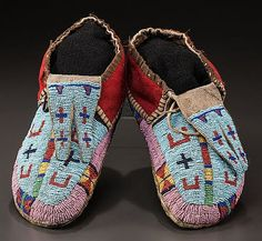 A PAIR OF CROW PICTORIAL BEADED BUFFALO HIDE MOCCASINS c. 1880