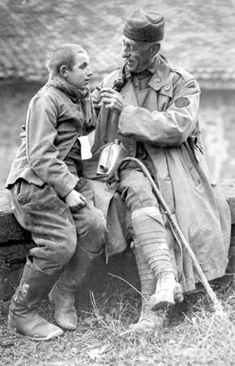 American Army chaplain helps a young German prisoner-of-war  As Germany in 1918 ran out of cannon fodder, they had to commit very young soldiers to battle.
