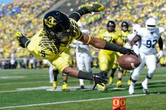 Oregon Ducks running back Taj Griffin (5) dives as he tries to make it into the endzone. The No. 12 Oregon Ducks play the Georgia State Panthers in Eugene Oregon on September 19, 2015. Adam Eberhardt/Emerald)
