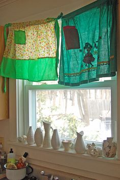 Adorable! Use vintage aprons as curtains in the kitchen!
