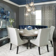 Blue ceiling in gray dining room with round table