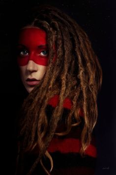 Interesting style! Dreadlocks and red/black sweater with red eye mask make up
