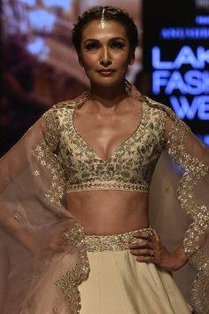 Love this ivory gold floral lehenga blouse by Anushree Reddy Floral Lehenga, Lehenga Blouse, Bridal Lehenga Choli, Bridal Sarees South Indian, Indian Bridal Outfits, Dress Indian Style, Indian Fashion Dresses, Lehenga Modern, Half Saree Designs