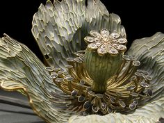 the intricate and exquisitely detailed work of Renee Lalique.