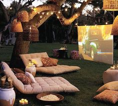 Movie Theater | Projector Screen | String Lights | Patio Lighting | Backyard Ideas