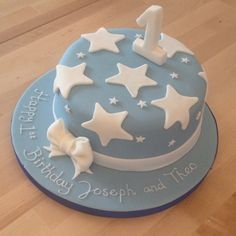 1st birthday cake for a boy. Baby blue with white stars, white icing ribbon and model number 1. Piped writing, Madeira sponge. 8'' round cake. Email sugarmamabakery@hotmail.com for enquiries
