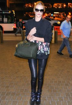 Rosie Huntington-Whiteley arrives at LAX wearing Helmut Lang leather leggings. #streetstyle #helmutlang