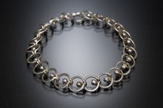 Bead Hammered Linked Loop Ball and Tab, Anne Mitchell