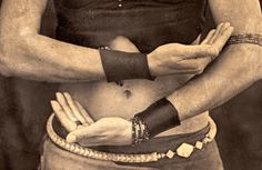 Female shamans hands holding energy.