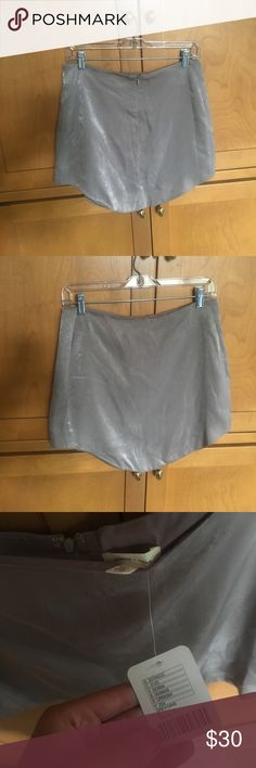 Urban Outfitters high waisted skirt High waisted and somewhat fitted skirt with a scalloped hemline. Silky material. Grey/champagne color. Urban Outfitters Skirts Mini