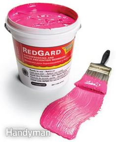 Red paint before installing tile to make the surface impenetrable to water and moisture