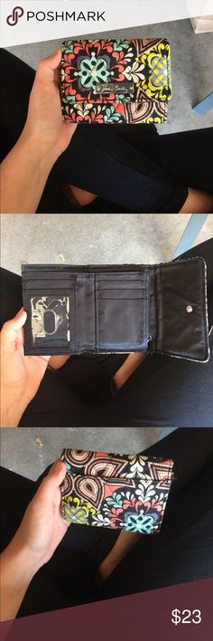 VERA BRADLEY WALLET Button up wallet - 5 card pockets 1 id pocket - big money pocket and change pocket on the back. Reasonable offers no trades Vera Bradley Bags Wallets