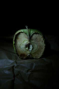 A photographic image, showing what happens when Apples decay. The use of dark background, dark lighting and dark surface that contrasts with the green decaying apple emphasises a sort of death theme in this image. As decay symbolises death. Fruit Photography, Time Photography, Photography Projects, Still Life Photography, Texture Photography, Snow White Photography, Backlight Photography, Photography Composition, Photography Aesthetic