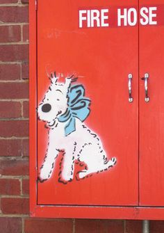 Old stencil. Now painted over. Tintin's dog Snowy. (He's a Wire Fox Terrier)
