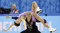 Meryl Davis and Charlie White of the United States compete in the ice dance free dance figure skating finals at the Iceberg Skating Palace d...