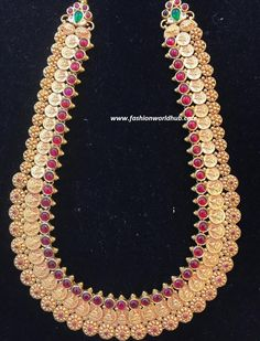 22 cart gold hand crafted lakshmi kasula haram adored with rubies, CZ stone and emerald.For details :- Omprakash Jewellers and PearlsContact number :- 9550170099 Gold Haram, Peacock Design, Chains, Cart, Emerald, Pearl Necklace, Number, Jewels, Jewellery