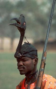 Africa | Young Fulani tribesman, a hunter, with bird's headdress. Kaduna Durbar. 1977, Nigeria | ©Bruno Barbey.