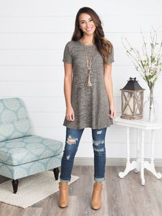 """This everyday tunic dress is flattering and oh-so comfortable. Throw it on and go or style it with leggings or skinnies for a more layered look. The stretchy knit smooths your curves while the crewneck, short sleeves and a-line fit keep you comfortable all day long. We've paired it with the faith stone tassel necklace, olivia distressed skinny jeans and the victoria buckled booties. 100% Acrylic. Runs true to size with generous stretch. Lacy is size 0, 5'8"""" height, and wearing a small. For…"""