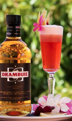 Here's the Magic Cocktail Recipe: -4cl Drambuie -2,5cl Fresh Lemon Juice -2cl Rasberry/Basil purée  -1,5cl egg white  -1 Barspoon of Maraschino Glass: Sour Glass Method: Dry shake, shake and fine strain Ice : None  Garnish: Lemon Zest, Angostura hearts(drops) & a Rasberry.