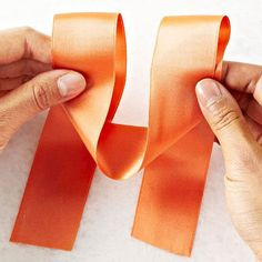Need a fun gift-wrapping idea? Learn how to make a bow (or three!) to create gorgeous gifts. We'll show you how to tie three different bows -- classic, layered, and rosette -- with ribbon.